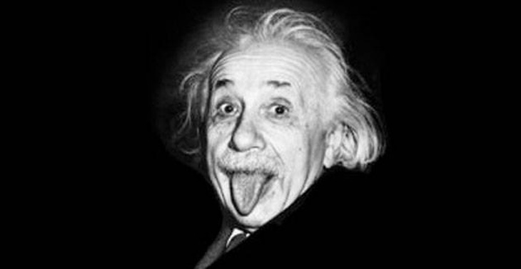 albert einstein on a black and white photo stick out tongue