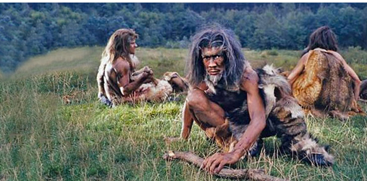 3 neanderthal sitting on grass