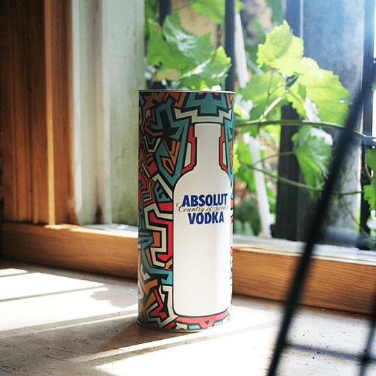 Absolut tin box in front of window