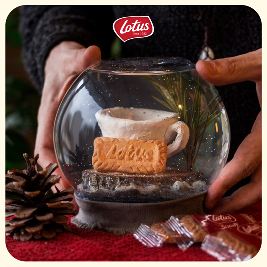 lotus biscoff social media visual, snow globe and hands